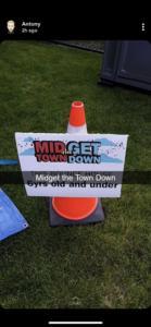 Midget the town down